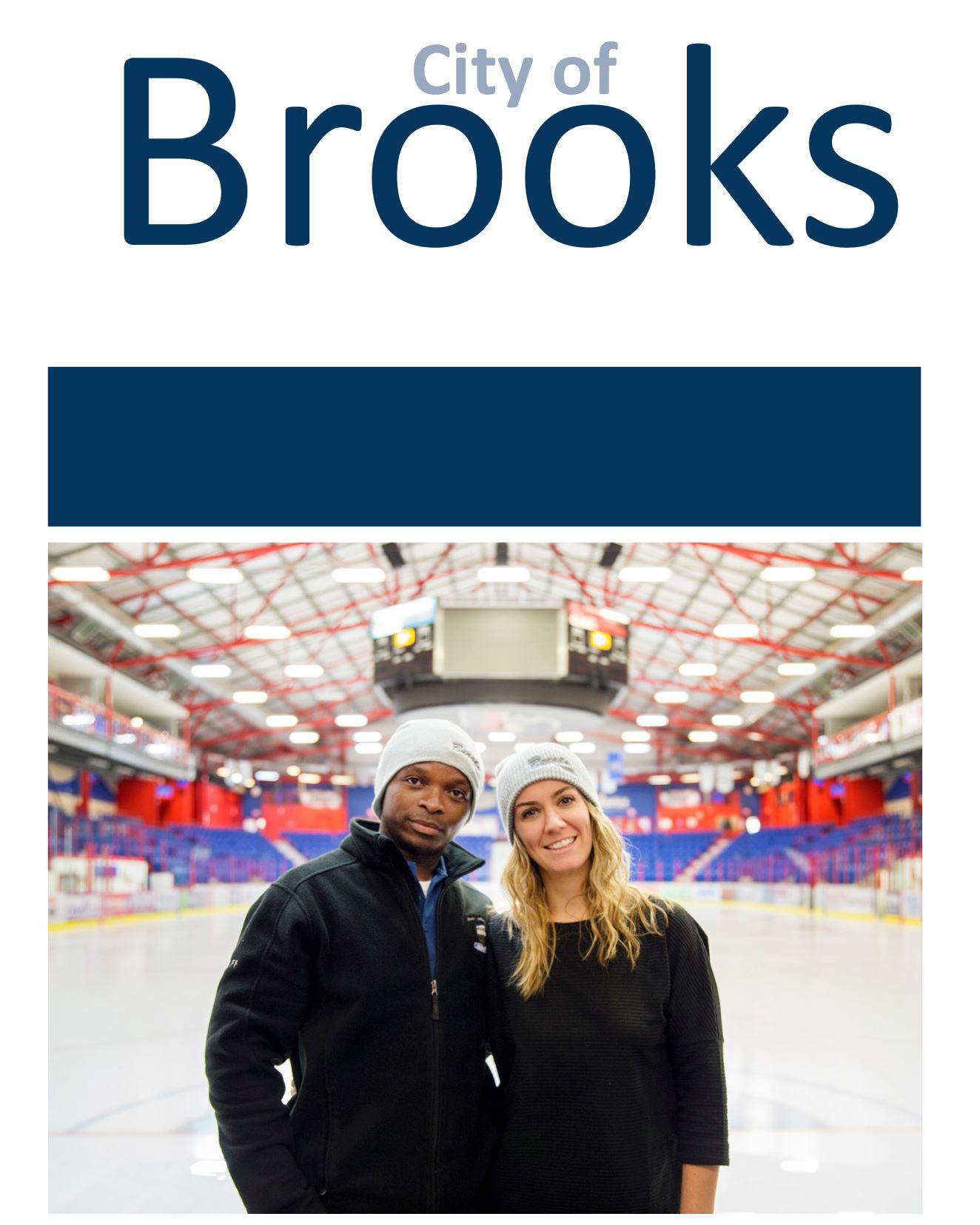 City of Brooks, two people posing in an ice rink facility