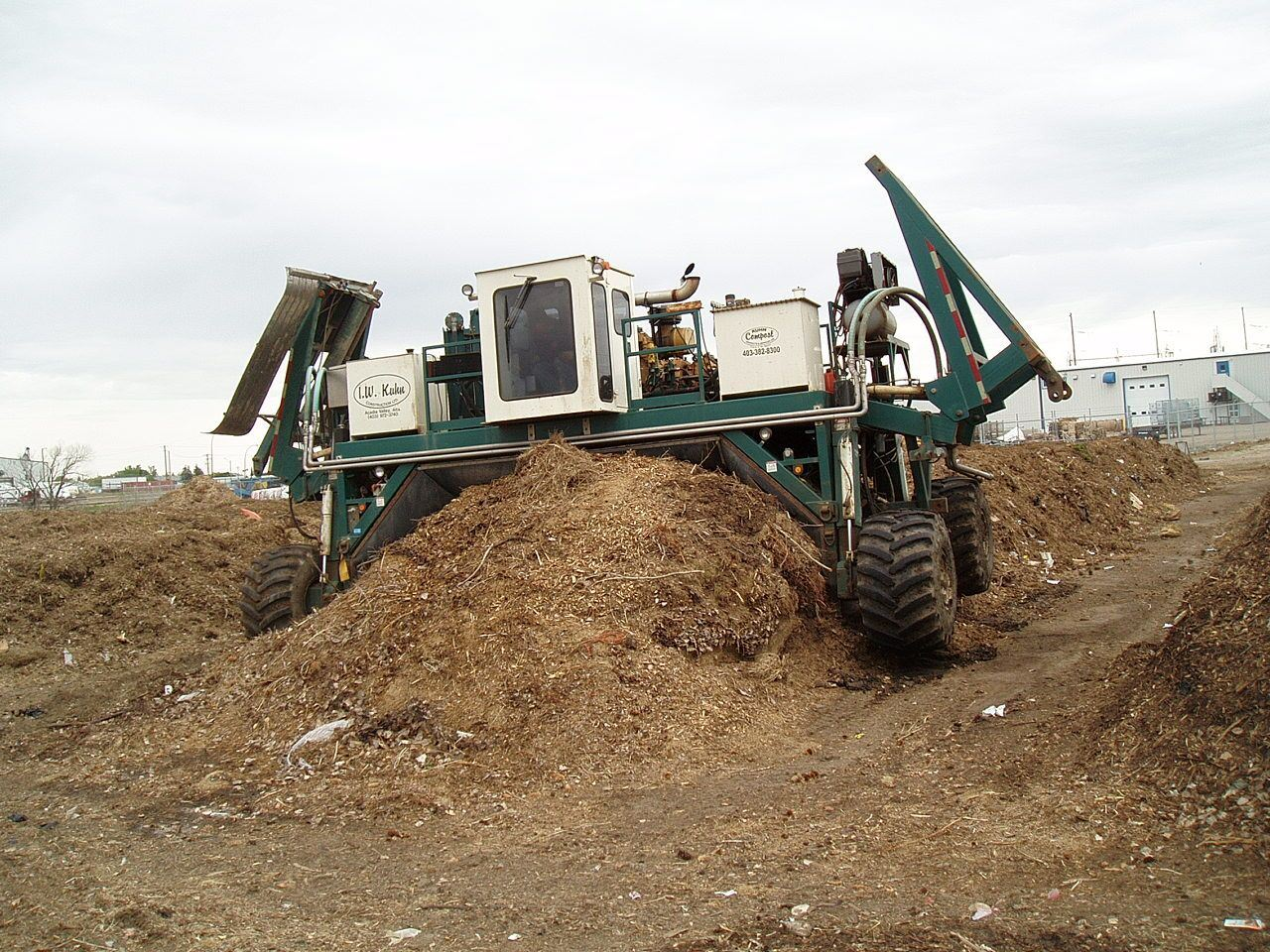 Compost site turner machine in use