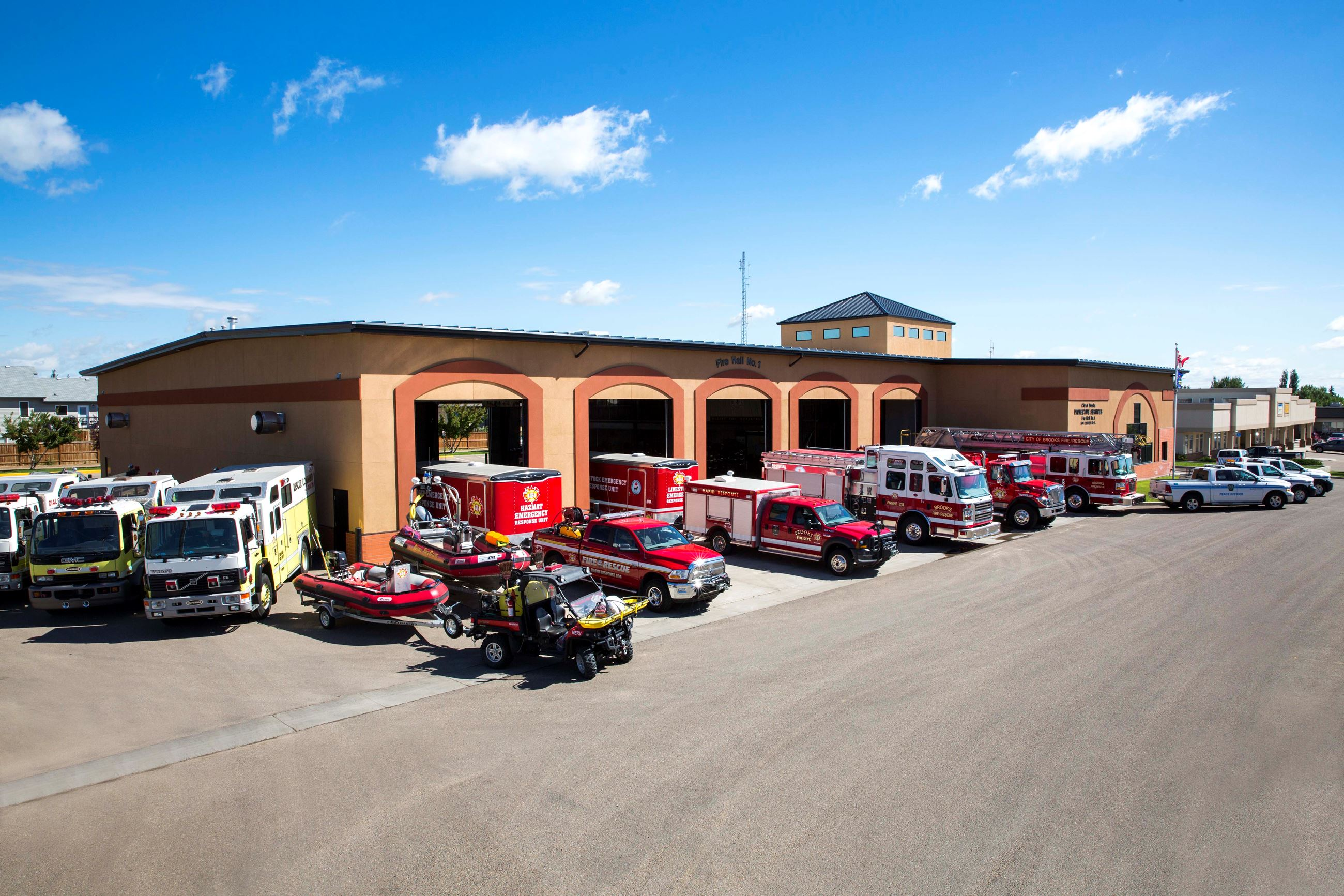 Fire station with emergency response vehicles parked in all bays